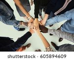 group of people holding hand... | Shutterstock . vector #605894609