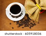 coffee in white cup and saucer  ... | Shutterstock . vector #605918036