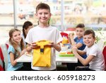 cute boy holding lunch bag and... | Shutterstock . vector #605918273