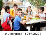 children sitting at cafeteria... | Shutterstock . vector #605918279
