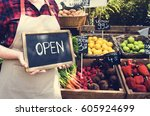greengrocer selling organic... | Shutterstock . vector #605924699
