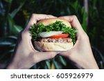 eat hamburger on night   Shutterstock . vector #605926979