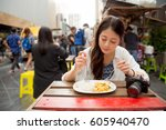restaurant tourists eating at... | Shutterstock . vector #605940470