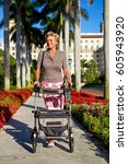 Older Woman Walking With A...