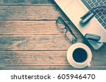 coffee and laptop on wooden... | Shutterstock . vector #605946470