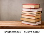 stack of books on wooden table... | Shutterstock . vector #605955380