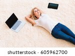 Young Woman Lying Down On A...