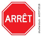 red vector arret sign  french... | Shutterstock .eps vector #605973518