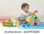 cute baby boy sitting on a... | Shutterstock . vector #605993684