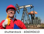 oil worker gesturing thumb up... | Shutterstock . vector #606040610