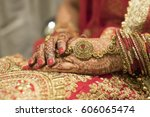 bridal dress and hand of bride ... | Shutterstock . vector #606065474
