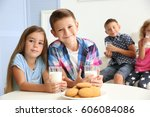 little boy and girl with... | Shutterstock . vector #606084086