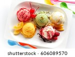 Stock photo fruit ice cream scoops overhead on white plate with pieces of fruits and berries served with 606089570