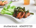 fried chicken wing in white... | Shutterstock . vector #606095720