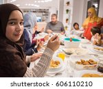 family gathering eating meal... | Shutterstock . vector #606110210