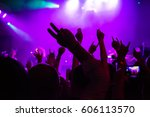 dancing audience at concert at... | Shutterstock . vector #606113570