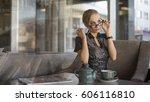 young businesswoman drinking tea | Shutterstock . vector #606116810