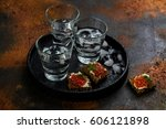 vodka shots with ice and small... | Shutterstock . vector #606121898