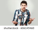 portrait of confused young man... | Shutterstock . vector #606145460