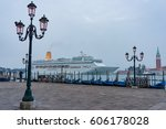 Small photo of Venice, Italy - September 28, 2013: Oriana cruise liner on Grand Canal at early morning with parked gondolas and San Giorgio Maggiore tower