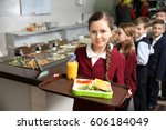 Stock photo cute girl holding tray with delicious food in school cafeteria 606184049