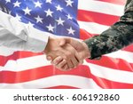 soldier and civilian shaking... | Shutterstock . vector #606192860