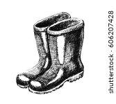 rubber boots. hand drawn sketch | Shutterstock . vector #606207428