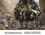 mechanical claw hand grabbing... | Shutterstock . vector #606219353