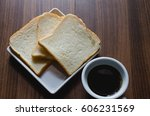 black coffee and bread on wood... | Shutterstock . vector #606231569