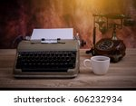 the old typewriter on wood... | Shutterstock . vector #606232934