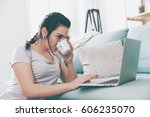 young woman using laptop and... | Shutterstock . vector #606235070