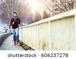 handsome urban runner having... | Shutterstock . vector #606237278