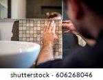 industrial worker applying... | Shutterstock . vector #606268046