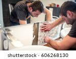 close up of handyman fixing and ... | Shutterstock . vector #606268130