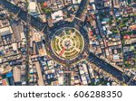 road roundabout with car lots... | Shutterstock . vector #606288350