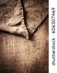 burlap texture on wooden table... | Shutterstock . vector #606307469