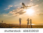 Airplane Fly Over The Beach In...