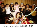 young adults sitting side by... | Shutterstock . vector #606321758
