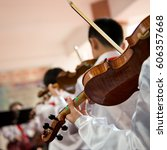 the pupils playing the violin. | Shutterstock . vector #606357668
