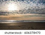 late afternoon on the beach in... | Shutterstock . vector #606378470