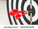 arrows hitting the center of a... | Shutterstock . vector #606404540