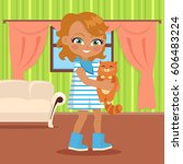 girl holds small cat in her... | Shutterstock . vector #606483224