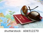 Small photo of travel concept, two passports on the map of the world, holidays abroad