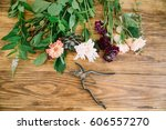 Cut Flowers Laid Out On A Wood...