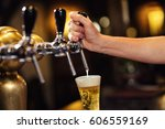 bartender pouring from tap... | Shutterstock . vector #606559169