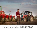 young farmer with laptop... | Shutterstock . vector #606562760