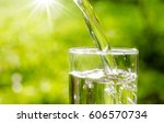 drink water pouring in to glass ... | Shutterstock . vector #606570734