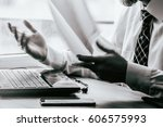 young businessman sitting...   Shutterstock . vector #606575993