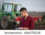 young farmer with laptop...   Shutterstock . vector #606578228