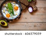 healthy breakfast with eggs and ... | Shutterstock . vector #606579059